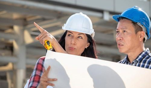 engineer-woman-is-pointing-for-project-manager-to-see-building_t20_axQ2rp